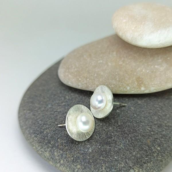 Hana Sun earrings.